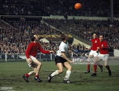 England defenders Nobby Stiles (left), Martin Peters and Ray Wilson (right) converge on West Germany striker Siegfried Held during the FIFA World Cup Final between England and West Germany at Wembley Stadium in London, July England won after extra time. 1966 World Cup Final, Martin Peters, Bristol Rovers, England International, Nobby, England Football, Wembley Stadium, Stiles, Fifa World Cup
