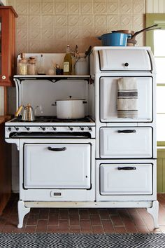 Name of stoves like this are:Aga; Westwood; Chambers and Magic Chef(One pictured)