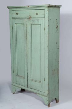 Thin cupboard like this for the powder room