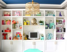 When I decided to decorate my built-ins like a rainbow, I wasn't 100% sure I would have enough of a decor-spectrum to pull it off (an earth...