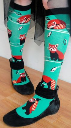 Cuddly red pandas lounge, snooze, and play on these minty green knee high socks for women. This ModSock original design is also available in a women's crew sock.