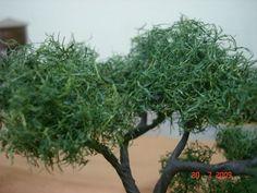 Foto 1 - Árvore feita de bucha vegetal.