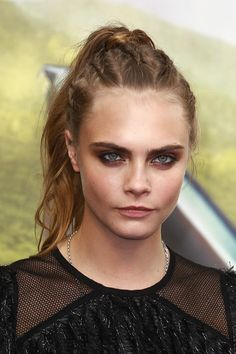 Take a cue from Cara, and spice up your basic ponytail with some edgy inside-out braids.
