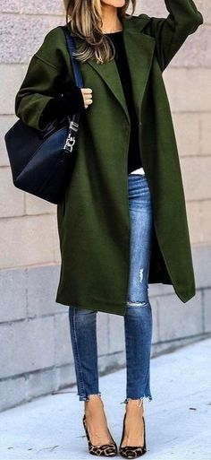 green coat. skinny jeans. animal print heels. #streetstyle