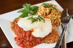 Perfect Chicken Parmesan is the best chicken parmesan recipe you'll find. Full of flavor, takes minutes to cook, and is my favorite chicken dinner recipe!