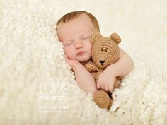 Tallahassee newborn photographer with baby boy on classic traditional white blanket with snuggle soft crochet teddy bear
