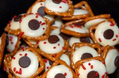 Edible Eyeballs    Just melt white chocolate onto a square pretzel.  Add red sprinkles and a chocolate chip.  Holloween fun!