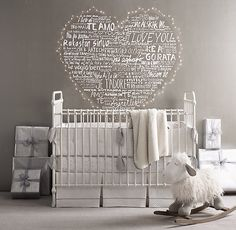 RH baby&child's Kennedy Iron Crib:Our crib's simple curves, round spindles and ball feet evoke a quintessential Americana. Inspired by an antique, it is expertly crafted of iron and features a distressed white finish that evokes the look of a cherished family heirloom.