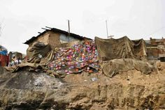 In a second installation at Kawukudi Junction, Nima, the middle segment of cloth was covered with Chinese wax print, of the type the coal-se...