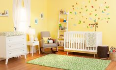 This nursery was designed by OhJoy and was inspired by Skip*Hop's Complete Sheet, the Treetop Friends Collection