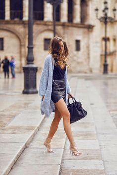 fashion blogger style | blue cardigan, black faux leather skirt with black v-neck top.