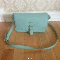 Forever 21 Mint Crossbody Bag Condition: New  *Will not respond to offers made in the comments, so please use the OFFER BUTTON to make offers!  *NO TRADES. *Any questions or concerns, feel free to ask :) Forever 21 Bags Crossbody Bags