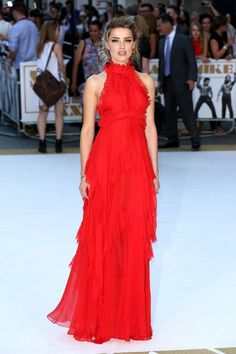 Amber Heard looks stunning in  a red silk chiffon Emilio Pucci halter gown to the European premiere of Magic Mike XXL in London.