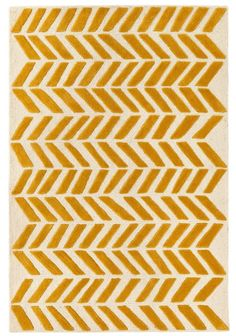 Shop Gold Bars Rug.  You could put your Gold Bars Rug in a vault for safekeeping.  But you should probably put it on your floor and enjoy its 100% wool softness and bold chevron pattern.  It was designed just for us by Blake Kahan.