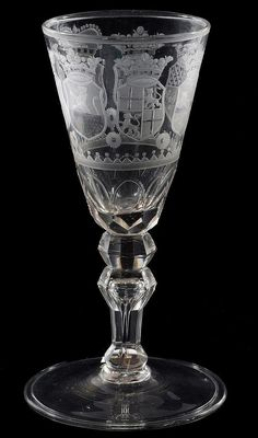 An engraved armorial goblet for the Dutch market, probably Saxon or Bohemian, the funnel bowl with faceted lower section and engraved with the arms of the United Dutch Provinces, on a faceted inverted baluster stem and faceted ball knop, 21cm high