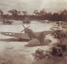 An old Curtiss SB2C Helldiver sitting in an airfield in the Philippines.
