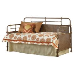 Antiqued day bed with turned detailing and a matching trundle.  Product: Daybed and trundleConstruction Material:
