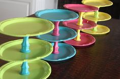 Make your own cupcake stands from things at the dollar store and a little spray paint. Made with plastic plates or faux metal ones and candle stick holders.