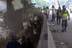 Riot police watch demonstrators after clashes during a rally against President Nicolas Maduro, in Caracas, Venezuelan. (EFE) http://pow.photos/2017/international-pow-18-24-april/