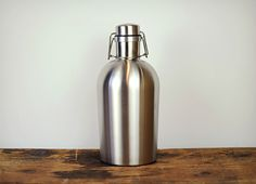 Stainless Steel Growler w/ flip top lid Material