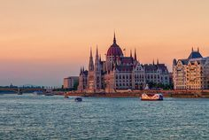 Colorful sunset on Hungarian Parliament Building in Budapest, Hungary Famous Places, Budapest Hungary, Travel Photos, Fine Art America, New York Skyline, Sunset, Building, Beautiful, Sunsets
