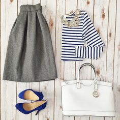 Grey pleated skirt, striped crop top, Ily Couture opera bib necklace, Jcrew blue suede pumps, white purse   // Click the following link to see outfit details and photos: http://www.stylishpetite.com/2015/03/instagram-lately-daily-outfits-outfit.html