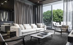Minotti company showroom. Blazer seating system, Rodolfo Dordoni design; Fynn armchair and coffee table, GamFratesi design. #minotti #company #showroom #gamfratesi #rodolfodordoni Video Wall, Exhibition Space, Outdoor Furniture Sets, Outdoor Decor, Outdoor Projects, Showroom, Living Spaces, Armchair, Dining Table