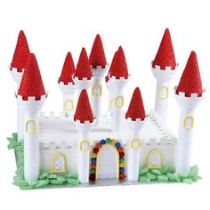 A 2-layer Sheet Pan cake provides the base for a congenial castle. Use red icing to cover Romantic Castle Cake Set turrets; accentuate architectural elements with gum drops, sugar cubes and piped-icing details