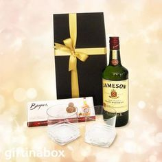 A DOUBLE SHOT A double shot . one chocolate Scottish whiskey truffles and one Irish whiskey beautifully presented in a black box with two whiskey tumblers. Jameson Irish whiskey Box of Scottish whiskey truffle chocolates 2 x whiskey tumblers Jameson Irish Whiskey, Scotch Whiskey, South African Wine, Whiskey Gifts, Double Shot, Wine And Liquor, Gift Hampers, Chocolate Truffles, Black Box