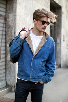 Pair a blue denim jacket and navy jeans to get a laid-back yet stylish look. Shop this look for $229: http://lookastic.com/men/looks/white-crew-neck-t-shirt-and-blue-denim-jacket-and-black-briefcase-and-navy-jeans/556 — White Crew-neck T-shirt — Blue Denim Jacket — Black Briefcase — Navy Jeans