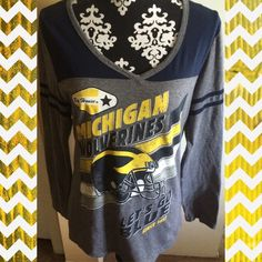 Michigan Wolverines Lightweight Long Sleeved Tee Michigan Wolverines Lightweight Long Sleeved Tee. Tee is super cute, stylish, and very unique! Tee is in like new condition. Go Blue! Creative Apparel Tops