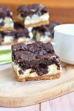 Chocolate Cheesecake Bars: graham cracker crust, creamy vanilla cheesecake and chocolate cookie crunch on top make these the perfect dessert!