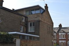 Contemporary Wandsworth loft conversion and kitchen side return with high level glass panels and metal roof detail. Loft Conversion Extension, Loft Conversions, Side Return, Roof Detail, Flat Roof, Metal Roof, Project Management, Glass Panels, Nice View