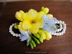 yellow pearl wristlet corsage | Floral Design by Perfect Princess Events