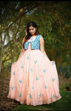 Beautiful peach floor length dress with floral design hand embroidery thread work. Floor length dress with powder blue color over coat. Saree Blouse Patterns, Saree Blouse Designs, Kurti Patterns, Dress Designs, Indian Wedding Gowns, Indian Gowns Dresses, Wedding Dress, Cotton Long Dress, Long Frock