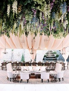 Beautiful reception tent with pink draping and a floral canopy comprised of over 14,000 individual stems of a mix of delphiniums, Queen Anne's lace, larkspur, and foraged greens.~ http://www.brides.com/blogs/aisle-say/2016/06/flower-filled-cincinnati-ohio-wedding-ideas-leo-patrone-photography.html