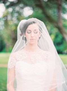 Sweeping veil and beautiful bridal makeup: http://www.stylemepretty.com/2014/02/07/parisian-glamour-inspiration-shoot/ | Photography: Michelle March - http://michellemarch.com/