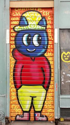 Funny blue boy in Vertbois street, 3th district of Paris.