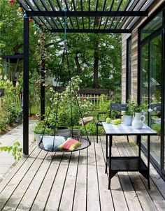 Terrasse mit Nestschaukel Terrace with nest swing Related posts: Legend Exterior Cedar Swing Bed&Pergola gabions as decoration in the garden bench dining table terrace furniture wood slats