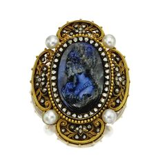 LABRADORITE CAMEO, DIAMOND AND PEARL LOCKET-BROOCH, CIRCA 1890. The oval cameo carved with the profile bust of a woman in neo-Renaissance style, surrounded by rose-cut diamonds, the openwork quatrefoil frame decorated with floral sprigs of rose-cut diamonds and accented with pearls at the quarters, the reverse with glazed locket compartment, mounted in gold.