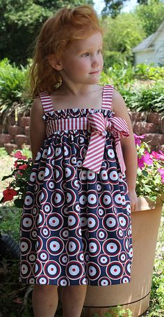 """Jo Jo Goes to the Parade"" dress. Fabrics and patterns can be found at www.farmhousefabrics.com"