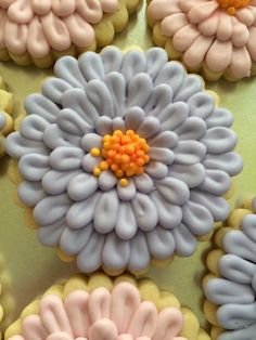 Cookies with Character: Zinnia Flower Cookies Over the yellow icing dots in the centre, use a darker petal dust in the center of the flower, such as a Red, Deep Pink or even a Terracotta.