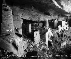 View of Native American (Anasazi) ruins at Cliff Palace, Mesa Verde National Park, CO. Shows stone walls  round  square multi-story cliff dwellings. Stone bricks are scattered on the ground.