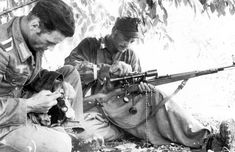 German sniper team takes a break to clean weapons and equipment. The K98k-4221 sniper rifle is clearly visible. Chambered for the 7.92X57mm Mauser cartridge, the K98k was also the standard service rifle for the German army. The rifle wears the Zeiss Zielvier 4x (ZF39) telescopic sight.