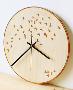 Modern wall clock for your beautiful home. This wood wall clock will bring art, nature and joy in your nest. We bet your friends will compliment your style and feeling this clock makes. Looks great in any interior and room!  Size: ♢ 12 inch; 29 cm diameter ♢ 0.15 inch; 0,39 cm thin Material: ♢ Natural birch plywood, FSC certified ♢ Light brown with random wood grains Silent clock mechanism: ♢ Runs on AA battery, not included ♢ 24 month guarantee, Rohs certified   More wall clocks…