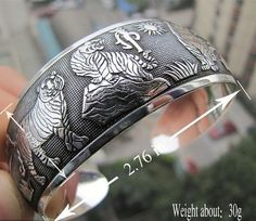 CUFF114 Tibetan Silver CUFF bracelet, with TIGER motif. Normally retails for around $55 each - my selling price (including postage within Australia) is $25.00 each... Please feel free to contact me if your require price for postage overseas…