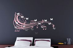 Butterfly Mirrors with fun music note wall decal behind. Very neat. - I want this in my room more then ANYTHING I've found