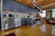 This reminds of the kitchen in Love Jones Toronto Lofts, Centre Island, Hardwood Floors, Flooring, Exposed Brick Walls, Open Concept Kitchen, Wood Ceilings, Beams, The Unit