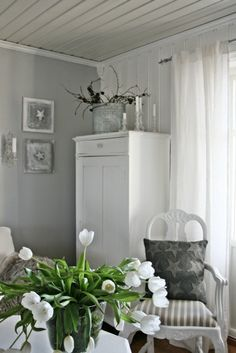 Lovely gray and white room with white tulips