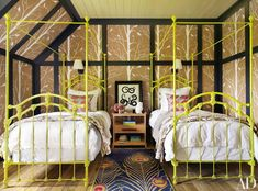 """whimsical // """"A peacock-printed rug, woodsy wallpaper, and a pair of vintage bed frames in a Benjamin Moore green make for a girl's bedroom that's unabashedly hip."""" camp designed by Thom Filicia Architectural Digest, Four Poster Bedroom, Poster Beds, Kids Bedroom, Bedroom Decor, Bedroom Ideas, Nursery Ideas, Room Kids, Wall Decor"""